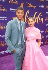 """LOS ANGELES, CA - MAY 21: Jordan Spence (L) and Naomi Scott attend the World Premiere of Disney's """"Aladdin"""" at the El Capitan Theater in Hollywood CA on May 21, 2019, in the culmination of the film's Magic Carpet World Tour with stops in Paris, London, Berlin, Tokyo, Mexico City and Amman, Jordan. (Photo by Jesse Grant/Getty Images for Disney) *** Local Caption *** Naomi Scott; Jordan Spence"""