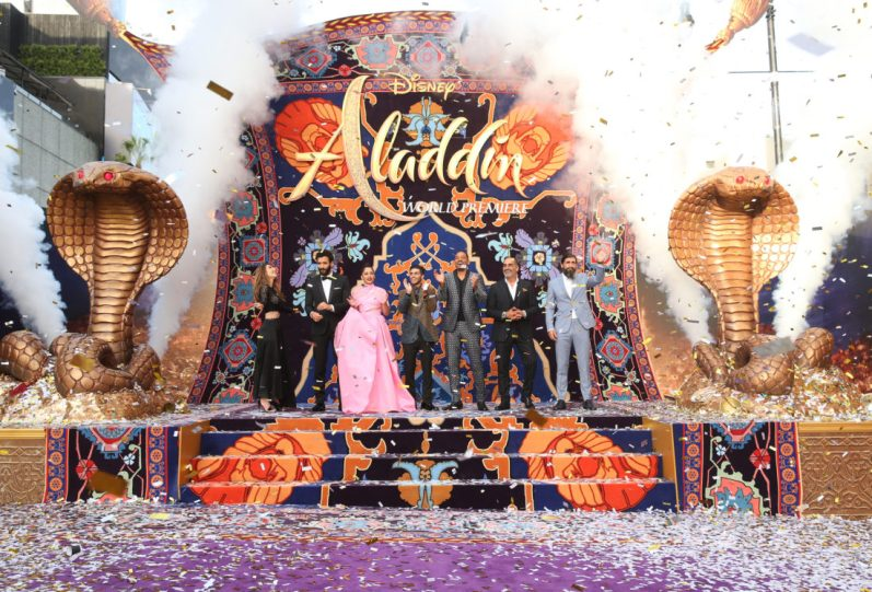 """LOS ANGELES, CA - MAY 21: (L-R) Actors Nasim Pedrad, Marwan Kenzari, Naomi Scott, Mena Massoud, Will Smith, Navid Negahban and Numan Acar attend the World Premiere of Disney's """"Aladdin"""" at the El Capitan Theater in Hollywood CA on May 21, 2019, in the culmination of the film's Magic Carpet World Tour with stops in Paris, London, Berlin, Tokyo, Mexico City and Amman, Jordan. (Photo by Jesse Grant/Getty Images for Disney) *** Local Caption *** Nasim Pedrad; Marwan Kenzari; Naomi Scott; Mena Massoud; Will Smith; Navid Negahban; Numan AcarNuman Acar"""