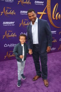 """LOS ANGELES, CA - MAY 21: Alfonso Ribeiro (R) and guest attend the World Premiere of Disney's """"Aladdin"""" at the El Capitan Theater in Hollywood CA on May 21, 2019, in the culmination of the film's Magic Carpet World Tour with stops in Paris, London, Berlin, Tokyo, Mexico City and Amman, Jordan. (Photo by Jesse Grant/Getty Images for Disney) *** Local Caption *** Alfonso Ribeiro"""