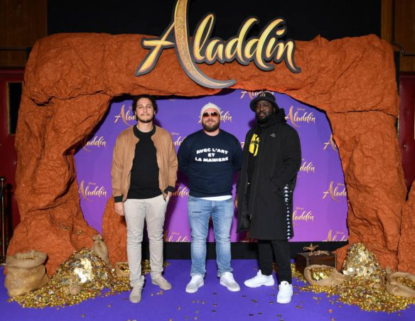 """PARIS, FRANCE - MAY 08: Alban Ivanov (C) and guest attend the """"Aladdin"""" gala screening at Le Grand Rex on May 08, 2019 in Paris, France. (Photo by Pascal Le Segretain/Getty Images For Disney)"""