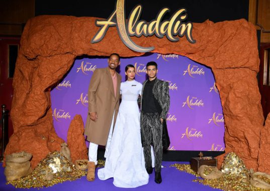 """PARIS, FRANCE - MAY 08: (L-R) Will Smith, Naomi Scott, wearing a Off-White by Virgil Abloh dress and Mena Massoud attend the """"Aladdin"""" gala screening at Le Grand Rex on May 08, 2019 in Paris, France. (Photo by Pascal Le Segretain/Getty Images For Disney)"""