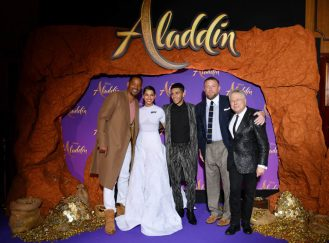 """PARIS, FRANCE - MAY 08: (L-R) Will Smith, Naomi Scott, wearing a Off-White by Virgil Abloh dress, Mena Massoud, Guy Ritchie and Alan Menken attend the """"Aladdin"""" gala screening at Le Grand Rex on May 08, 2019 in Paris, France. (Photo by Pascal Le Segretain/Getty Images For Disney)"""