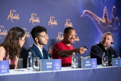"""(L-R) Naomi Scott, Mena Massoud, Will Smith and Guy Ritchie attend the """"Aladdin"""" press conference on May 11, 2019 in Berlin, Germany. .© Disney/Folioscope/Hanna Boussouar"""