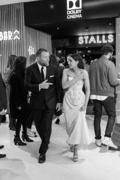 """LONDON, ENGLAND - MAY 09: (EDITORS NOTE: Image has been converted to black and white) Naomi Scott and Guy Ritchie attend the European Gala Screening of Disney's """"Aladdin"""" at Odeon Leicester Square on May 09, 2019 in London, England. (Photo by Gareth Cattermole/Getty Images for Disney)"""