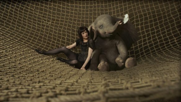 "NOTHIN' BUT NET – When high-flying star Colette Marchant teams up with a baby elephant who can fly, their new act proves a little challenging. Starring Eva Green as Colette, Disney's all-new, live-action adventure ""Dumbo"" opens in U.S. theaters on March 29, 2019...© 2019 Disney Enterprises, Inc. All Rights Reserved.."