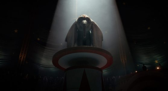"""WHEN I SEE AN ELEPHANT FLY -- In Tim Burton's all-new, live-action reimagining of """"Dumbo,"""" former circus star Holt Farrier (Colin Farrell) and his children (Nico Parker and Finley Hobbins) find themselves caring—and advocating—for a newborn elephant whose oversized ears make him a laughingstock in an already struggling circus. Directed by Burton and produced by Katterli Frauenfelder, Derek Frey, Ehren Kruger and Justin Springer, """"Dumbo"""" flies into theaters on March 29, 2019. © 2018 Disney Enterprises, Inc. All Rights Reserved."""