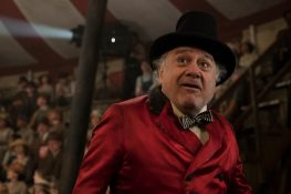 """MEET MEDICI -- In Tim Burton's all-new, live-action reimagining of """"Dumbo,"""" struggling circus owner Max Medici (Danny DeVito) is disappointed to learn that a newborn elephant has enormous ears. But when Medici realizes that the elephant can fly, the circus' return to prosperity suddenly becomes a real possibility. Directed by Burton and produced by Katterli Frauenfelder, Derek Frey, Ehren Kruger and Justin Springer, Disney's all-new, live-action reimagining of """"Dumbo"""" flies into theaters on March 29, 2019. Photo by Jay Maidment © 2018 Disney Enterprises, Inc. All Rights Reserved."""
