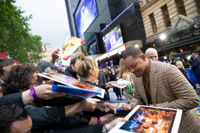 Will Smith signs autographs at the European Gala Screening of DisneyÕs ÒAladdinÓ on May 9th at LondonÕs ODEON Luxe in Leicester Square, London UK.