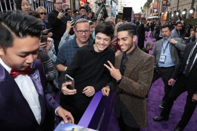Mena Massoud takes a selfie with a fan at the World Premiere of DisneyÕs Aladdin at the El Capitan Theater in Hollywood, CA on Tuesday, May 21, 2019, in the culmination of the filmÕs Magic Carpet World Tour with stops in Paris, London, Berlin, Tokyo, Mexico City and Amman, Jordan. (photo: Alex J. Berliner/ABImages)
