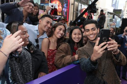 Mena Massoud takes a selfie with fans at the World Premiere of DisneyÕs Aladdin at the El Capitan Theater in Hollywood, CA on Tuesday, May 21, 2019, in the culmination of the filmÕs Magic Carpet World Tour with stops in Paris, London, Berlin, Tokyo, Mexico City and Amman, Jordan. (photo: Alex J. Berliner/ABImages)
