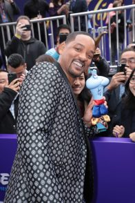 Will Smith poses with a genie doll at the World Premiere of DisneyÕs Aladdin at the El Capitan Theater in Hollywood, CA on Tuesday, May 21, 2019, in the culmination of the filmÕs Magic Carpet World Tour with stops in Paris, London, Berlin, Tokyo, Mexico City and Amman, Jordan. (photo: Alex J. Berliner/ABImages)