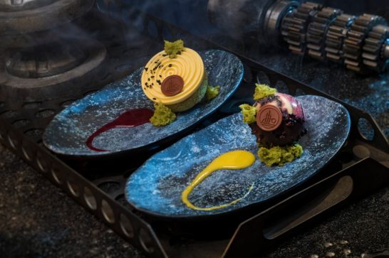 Innovative and creative eats from around the galaxy will be available at Star Wars: GalaxyÕs Edge when it opens May 31, 2019, at Disneyland Park in Anaheim, Calif., and Aug. 29, 2019, at Disney's Hollywood Studios in Lake Buena Vista, Fla. Guests can indulge in a raspberry crme puff with passion fruit mousse (left) or chocolate cake with white chocolate mouse and coffee custard (right) at Docking Bay 7 Food and Cargo inside Star Wars: GalaxyÕs Edge. (David Roark/Disney Parks)