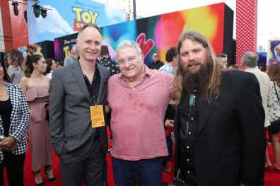 HOLLYWOOD, CA - JUNE 11: (L-R) Walt Disney Studios EVP of Music Tom MacDougall, Composer Randy Newman and Singer Chris Stapleton attend the world premiere of Disney and Pixar's TOY STORY 4 at the El Capitan Theatre in Hollywood, CA on Tuesday, June 11, 2019. (Photo by Rich Polk/Getty Images for Disney) *** Local Caption *** Randy Newman; Chris Stapleton; Tom MacDougall