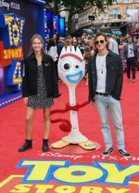 "LONDON, ENGLAND - JUNE 16: Maddy Elmer and Dougie Poynter attend the European premiere of Disney and Pixar's ""Toy Story 4"" at the Odeon Luxe Leicester Square on June 16, 2019 in London, England. (Photo by Gareth Cattermole/Getty Images for Disney and Pixar)"