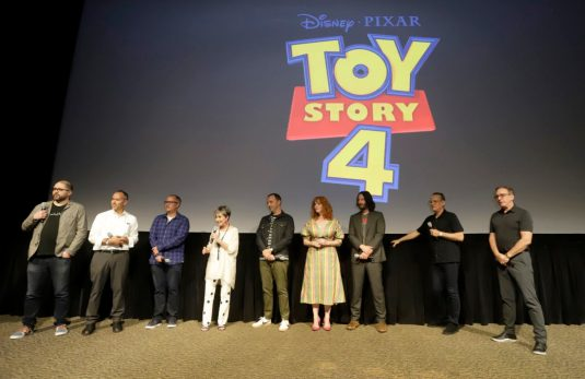 ORLANDO, FLORIDA - JUNE 08: (L-R) Josh Cooley, Jonas Rivera, Mark Nielsen, Annie Potts, Tony Hale, Christina Hendricks, Keanu Reeves, Tom Hanks and Tim Allen surprise fans at an early screening of Pixar's TOY STORY 4 at Disney's Hollywood Studios on June 08, 2019 in Orlando, Florida. (Photo by John Parra/Getty Images for Disney)