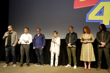 ORLANDO, FLORIDA - JUNE 08: (L-R) Josh Cooley, Jonas Rivera, Mark Nielsen, Annie Potts, Tony Hale, Christina Hendricks, and Keanu Reeves surprise fans at an early screening of Pixar's TOY STORY 4 at Disney's Hollywood Studios on June 08, 2019 in Orlando, Florida. (Photo by John Parra/Getty Images for Disney)