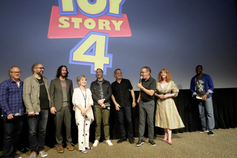 ORLANDO, FLORIDA - JUNE 08: (L-R) Mark Nielsen, Josh Cooley, Keanu Reeves, Annie Potts, Tony Hale, Tom Hanks, Tim Allen, Christina Hendricks, and Mark Daniel surprise fans at an early screening of Pixar's TOY STORY 4 at Disney's Hollywood Studios on June 08, 2019 in Orlando, Florida. (Photo by John Parra/Getty Images for Disney)