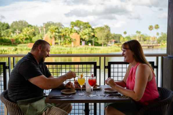 Guests can enjoy delicious entrees and shareables, along with refreshing cocktails and signature sangria pitchers at Three Bridges Bar & Grill, a casual waterside dining experience in an open-air setting located in Disney's Coronado Springs Resort at Walt Disney World Resort in Lake Buena Vista, Florida. (Steven Diaz, photographer)