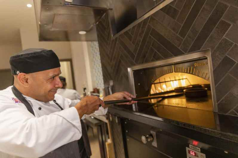 A chef prepares dishes in the onstage tapas kitchen located in Tolédo – Tapas, Steak & Seafood on the 16th floor of Gran Destino tower at Disney's Coronado Springs Resort. Gran DestinoTower opens July 9 at Walt Disney World Resort in Lake Buena Vista, Florida. (Steven Diaz, photographer)