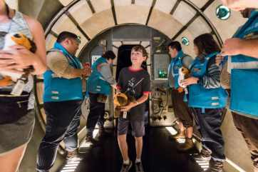 On Tuesday, July 16, 2019, Disneyland Cast Members welcome Jonathan Ridgeway of Ocean Springs, Mississippi, as he's named the millionth rider to take the controls of Millennium Falcon: Smugglers Run at Star Wars: Galaxy's Edge at Disneyland Resort in Anaheim, Calif. The family was welcomed in the Main Hold of Millennium Falcon with a surprise declaration, which included a visit by Chewbacca, followed by the ride experience and toasting blue and green milk with his family. This significant milestone comes just weeks since the land opened.. (Joshua Sudock/Disneyland Resort)