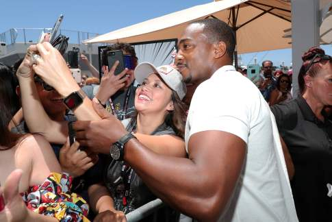 SAN DIEGO, CALIFORNIA - JULY 20: Anthony Mackie (R) and fans attend the #IMDboat at San Diego Comic-Con 2019: Day Three at the IMDb Yacht on July 20, 2019 in San Diego, California. (Photo by Rich Polk/Getty Images for IMDb)