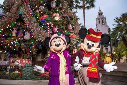 """The Disneyland Resort transforms into the Merriest Place on Earth for the holiday season, Nov. 8, 2019, through Jan. 6, 2020. Guests plan their seasonal visits to Disneyland Resort year after year to experience beloved Holiday traditions and festive cheer, from snowfall on Main Street, U.S.A., to glistening décor, Disney-themed treats and merchandise, holiday entertainment and one-of-a-kind transformations that create """"it's a small world"""" Holiday and Haunted Mansion Holiday. (Joshua Sudock/Disneyland Resort)"""