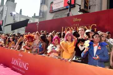"HOLLYWOOD, CALIFORNIA - JULY 09: Fans attend the World Premiere of Disney's ""THE LION KING"" at the Dolby Theatre on July 09, 2019 in Hollywood, California. (Photo by Alberto E. Rodriguez/Getty Images for Disney)"