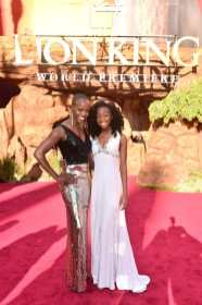 "HOLLYWOOD, CALIFORNIA - JULY 09: Florence Kasumba (L) and Shahadi Wright Joseph attend the World Premiere of Disney's ""THE LION KING"" at the Dolby Theatre on July 09, 2019 in Hollywood, California. (Photo by Alberto E. Rodriguez/Getty Images for Disney)"