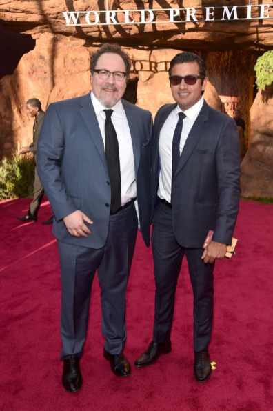 "HOLLYWOOD, CALIFORNIA - JULY 09: Director/Producer Jon Favreau and President, Marketing, The Walt Disney Studios Asad Ayaz attend the World Premiere of Disney's ""THE LION KING"" at the Dolby Theatre on July 09, 2019 in Hollywood, California. (Photo by Alberto E. Rodriguez/Getty Images for Disney)"