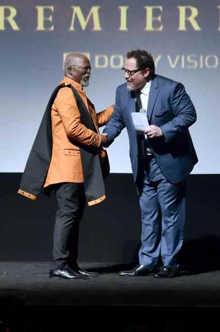 "HOLLYWOOD, CALIFORNIA - JULY 09: John Kani and Director/producer Jon Favreau attend the World Premiere of Disney's ""THE LION KING"" at the Dolby Theatre on July 09, 2019 in Hollywood, California. (Photo by Alberto E. Rodriguez/Getty Images for Disney)"