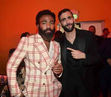 "HOLLYWOOD, CALIFORNIA - JULY 09: Donald Glover (L) and Marco Mengoni attend the World Premiere of Disney's ""THE LION KING"" at the Dolby Theatre on July 09, 2019 in Hollywood, California. (Photo by Alberto E. Rodriguez/Getty Images for Disney)"