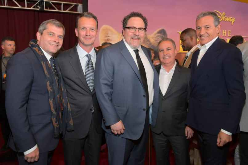 "HOLLYWOOD, CALIFORNIA - JULY 09: (L-R) Sam Dickerman, President of Walt Disney Studios Motion Picture Production Sean Bailey, Director/Producer Jon Favreau, Co-Chairman of The Walt Disney Studios Alan Bergman, and The Walt Disney Company Chairman and CEO Bob Iger attend the World Premiere of Disney's ""THE LION KING"" at the Dolby Theatre on July 09, 2019 in Hollywood, California. (Photo by Charley Gallay/Getty Images for Disney)"