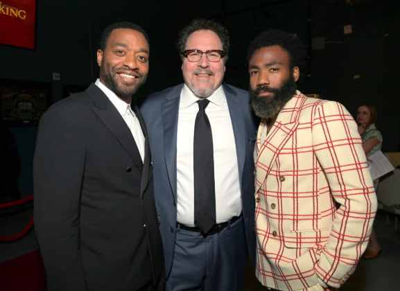 "HOLLYWOOD, CALIFORNIA - JULY 09: (L-R) Chiwetel Ejiofor, Director/producer Jon Favreau and Donald Glover attend the World Premiere of Disney's ""THE LION KING"" at the Dolby Theatre on July 09, 2019 in Hollywood, California. (Photo by Charley Gallay/Getty Images for Disney)"