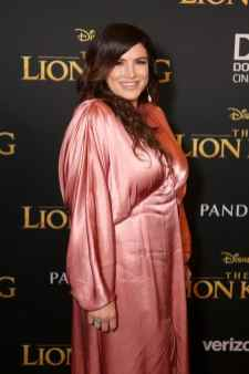 """HOLLYWOOD, CALIFORNIA - JULY 09: Gina Carano attends the World Premiere of Disney's """"THE LION KING"""" at the Dolby Theatre on July 09, 2019 in Hollywood, California. (Photo by Jesse Grant/Getty Images for Disney)"""
