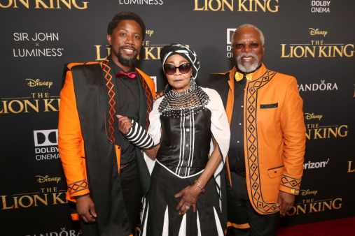 "HOLLYWOOD, CALIFORNIA - JULY 09: (L-R) Atandwa Kani, Mandi Kani, and John Kani attend the World Premiere of Disney's ""THE LION KING"" at the Dolby Theatre on July 09, 2019 in Hollywood, California. (Photo by Jesse Grant/Getty Images for Disney)"