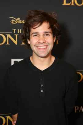 "HOLLYWOOD, CALIFORNIA - JULY 09: David Dobrik attends the World Premiere of Disney's ""THE LION KING"" at the Dolby Theatre on July 09, 2019 in Hollywood, California. (Photo by Jesse Grant/Getty Images for Disney)"