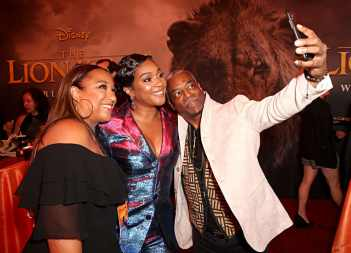 "HOLLYWOOD, CALIFORNIA - JULY 09: Stephanie Cozart Burton, Tiffany Haddish and LeVar Burton attend the World Premiere of Disney's ""THE LION KING"" at the Dolby Theatre on July 09, 2019 in Hollywood, California. (Photo by Jesse Grant/Getty Images for Disney)"