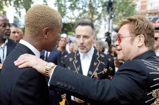 Pharrell Williams, David Furnish and Sir Elton John attend the European Premiere of DisneyÕs ÒThe Lion KingÓ at the Odeon Leicester Square on 14th July 2019 in London, UK