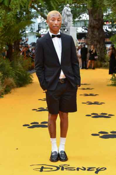 """Pharrell Williams attends the European Premiere of Disney's """"The Lion King"""" at the Odeon Leicester Square on 14th July 2019 in London, UK"""