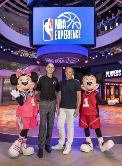 Disney Chairman and CEO Bob Iger (center right) and NBA Commissioner Adam Silver (center left) celebrate the grand opening of NBA Experience at Disney Springs, Aug. 12, 2019, at Walt Disney World Resort in Lake Buena Vista, Fla. The first-of-its-kind destination invites fans of all ages to enter the world of professional basketball in an immersive, interactive venue celebrating the NBA and WNBA. (David Roark, photographer)