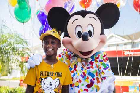 Mickey Mouse makes a surprise appearance at seven-year-old Jermaine Bell's birthday party Sept. 8, 2019, in Kissimmee, Fla. Mickey and Walt Disney World cast members were there to honor Jermaine who used money he'd saved for a Walt Disney World vacation to feed people fleeing Hurricane Dorian. Adding to a day filled with surprises, Jermaine learned that he and his family will be guests of Disney for a VIP getaway to the vacation kingdom later this month. (Disney)