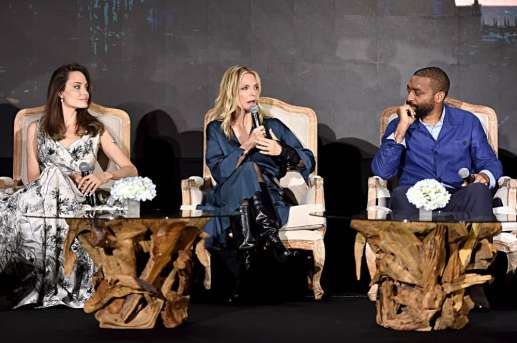 "BEVERLY HILLS, CALIFORNIA - SEPTEMBER 30: (L-R) Actors Angelina Jolie, Michelle Pfeiffer and Chiwetel Ejiofor participate in the global press conference for ""Disney's Maleficent: Mistress of Evil"" on September 30, 2019 in Beverly Hills, California. (Photo by Alberto E. Rodriguez/Getty Images for Disney)"