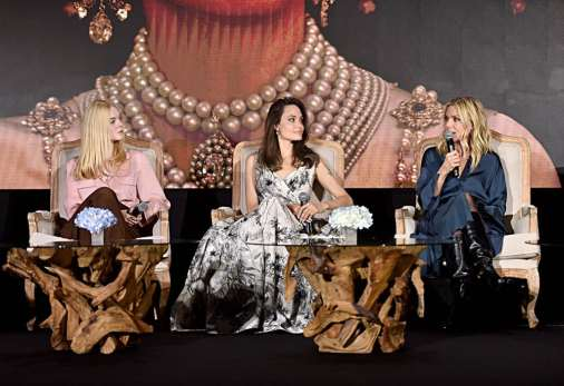 """BEVERLY HILLS, CALIFORNIA - SEPTEMBER 30: (L-R) Actors Elle Fanning, Angelina Jolie and Michelle Pfeiffer participate in the global press conference for """"Disney's Maleficent: Mistress of Evil"""" on September 30, 2019 in Beverly Hills, California. (Photo by Alberto E. Rodriguez/Getty Images for Disney)"""