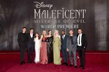"""HOLLYWOOD, CALIFORNIA - SEPTEMBER 30: (L-R) Actors Harris Dickinson, Sam Riley, Jenn Murray, Michelle Pfeiffer, Angelina Jolie, Elle Fanning, Chiwetel Ejiofor, Ed Skrein, and director Joachim Rønning attend the World Premiere of Disney's """"Maleficent: Mistress of Evil"""" at the El Capitan Theatre on September 30, 2019 in Hollywood, California. (Photo by Alberto E. Rodriguez/Getty Images for Disney)"""