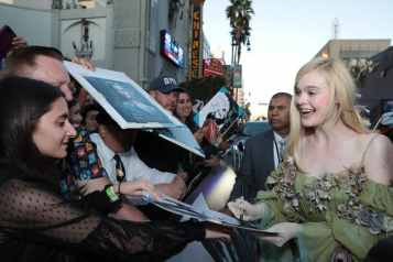 """Elle Fanning signs autograph for fans at the World Premiere of Disney's """"Maleficent: Mistress of Evil"""" at the El Capitan Theatre in Hollywood, CA on September 30, 2019 (photo: Alex J. Berliner/ABImages)"""