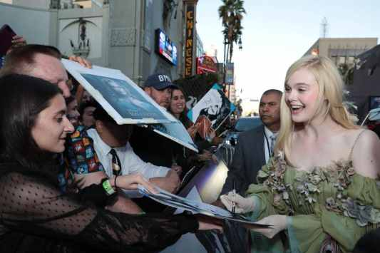 "Elle Fanning signs autograph for fans at the World Premiere of Disney's ""Maleficent: Mistress of Evil"" at the El Capitan Theatre in Hollywood, CA on September 30, 2019 (photo: Alex J. Berliner/ABImages)"