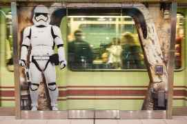 A First Order Stormtrooper appears to stand outside the shuttle station at Orlando International Airport in Orlando, Fla., Nov. 16, 2019, in an artistic rendering installed by Disney at the airport to bring the excitement of Star Wars: Galaxy's Edge at Disney's Hollywood Studios to airport travelers. (Steven Diaz, photographer)