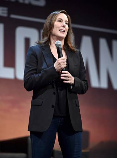 "HOLLYWOOD, CALIFORNIA - NOVEMBER 13: Executive Producer Kathleen Kennedy speaks onstage at the premiere of Lucasfilm's first-ever, live-action series, ""The Mandalorian,"" at the El Capitan Theatre in Hollywood, Calif. on November 13, 2019. ""The Mandalorian"" streams exclusively on Disney+. (Photo by Alberto E. Rodriguez/Getty Images for Disney)"