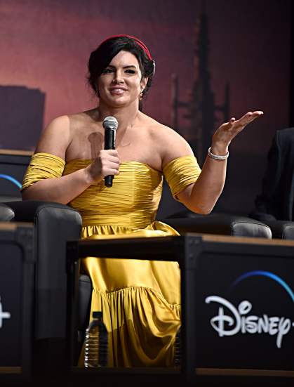 "HOLLYWOOD, CALIFORNIA - NOVEMBER 13: Gina Carano speaks onstage at the premiere of Lucasfilm's first-ever, live-action series, ""The Mandalorian,"" at the El Capitan Theatre in Hollywood, Calif. on November 13, 2019. ""The Mandalorian"" streams exclusively on Disney+. (Photo by Alberto E. Rodriguez/Getty Images for Disney)"