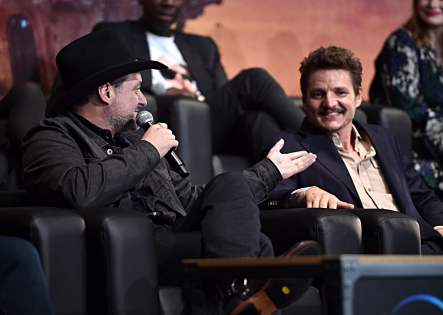 "HOLLYWOOD, CALIFORNIA - NOVEMBER 13: (L-R) Executive Producer/Director Dave Filoni and Pedro Pascal speak onstage at the premiere of Lucasfilm's first-ever, live-action series, ""The Mandalorian,"" at the El Capitan Theatre in Hollywood, Calif. on November 13, 2019. ""The Mandalorian"" streams exclusively on Disney+. (Photo by Alberto E. Rodriguez/Getty Images for Disney)"